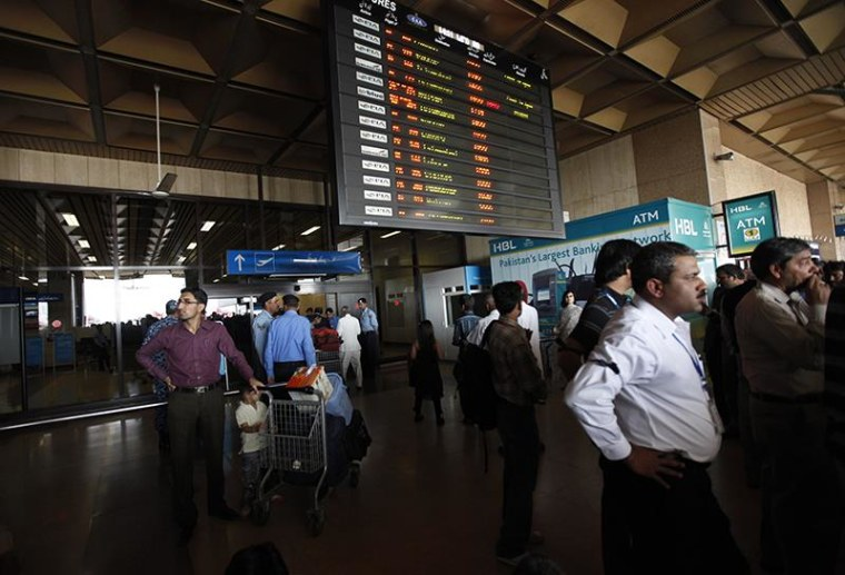 Passengers wait to get on a flight at Karachi's Jinnah International Airport in 2011.