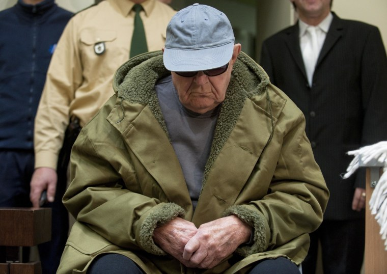 Image: John Demjanjuk arrives in a courtroom in Munich, Germany on March 22, 2011