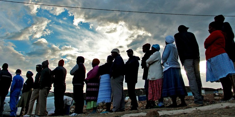 Voters queue to cast their ballots in De Doorns, in the winelands of the Western Cape province, South African, Wednesday May 7, 2014.  The country went to the polls in the fifth democratic elections since the end of apartheid in 1994.