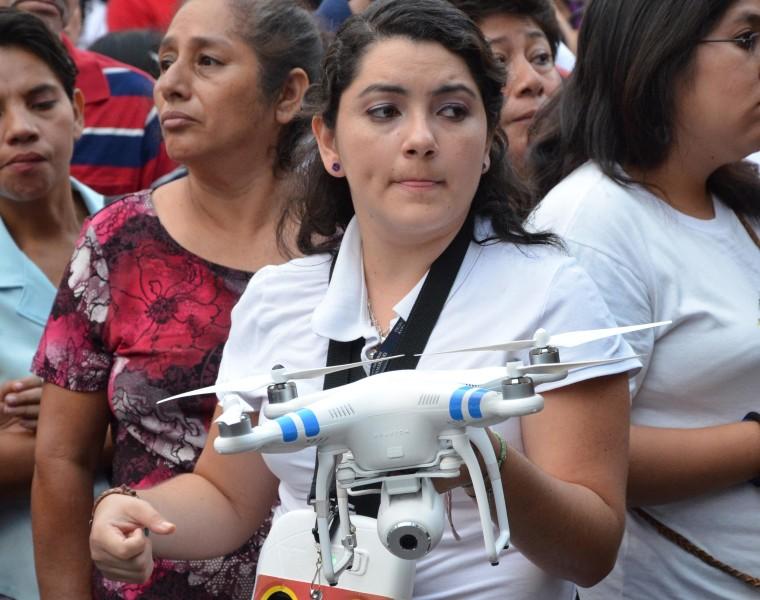 Reporters for El Salvador's newspaper La Prensa Grafica prepare to launch their drone.