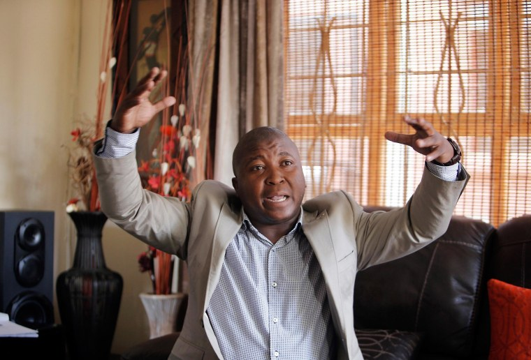 Image: Thamsanqa Jantjie gesticulates at his home during an interview