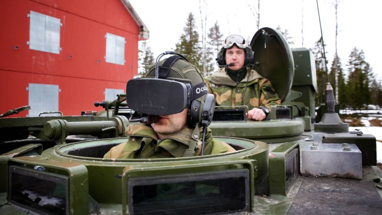A Norwegian soldier tests out the headset, which can also be used from inside the tank.