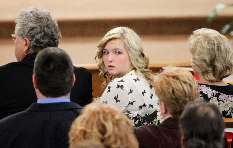 Image: File photo of Hannah Anderson looking back into the crowd during the memorial service for her mother and brother in Santee, California