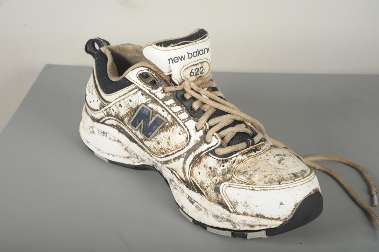 Image: This shoe, along with a foot inside, was discovered along the water in Seattle.