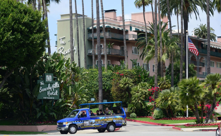 Image: A tour bus carrying passengers passes the Beverly Hills Hotel, owned by the Sultan of Brunei, on May 7, 2014, in Beverly Hills.