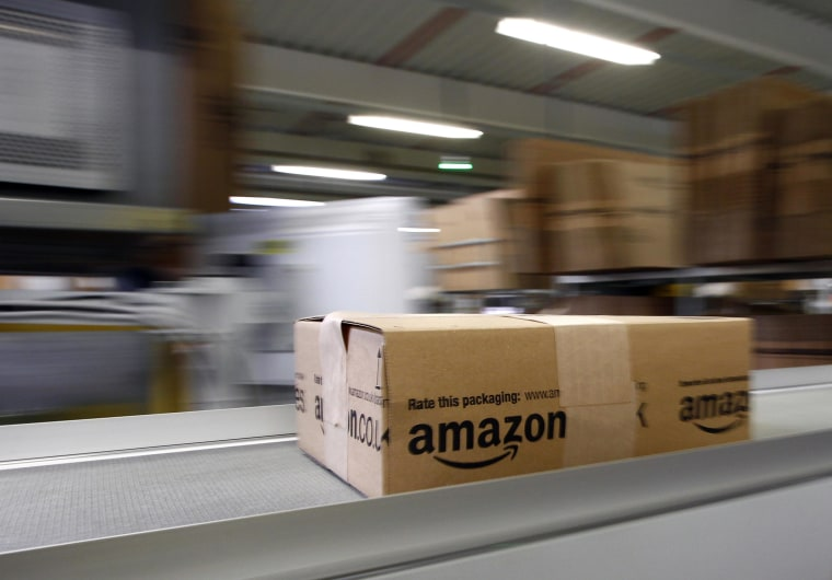 Image: A parcel moves on the conveyor belt at Amazon's logistics center