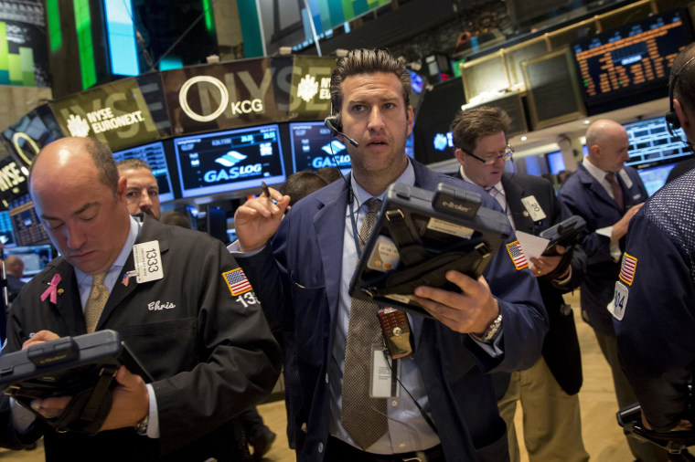 The Dow hit an intra-day record, as tech shares rebounded from a two-day rout.