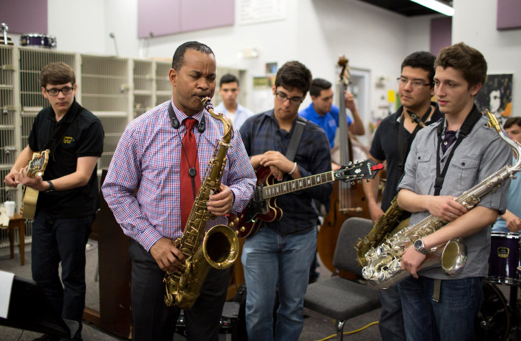 Image: Florida prep jazz band learns from professional