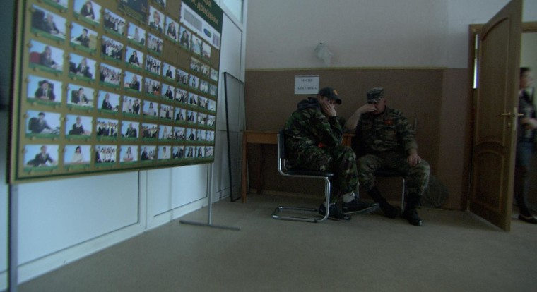 Two separatist militiamen sit guard after pro-Russian forces take control of a prominent TV station in Donetsk, Ukraine.