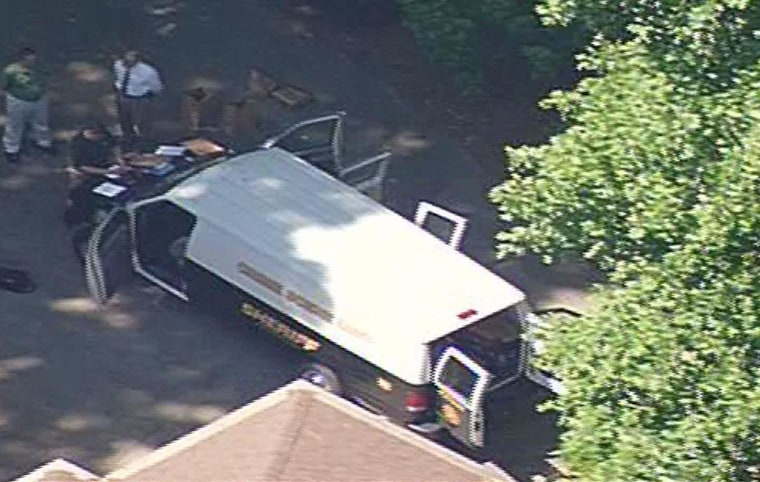 Image: Police are at the house where a man was discovered beheaded in Putnam County, Ga.