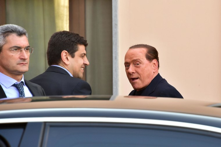 Image: Italian former Prime Minister Silvio Berlusconi arrives at the hospice