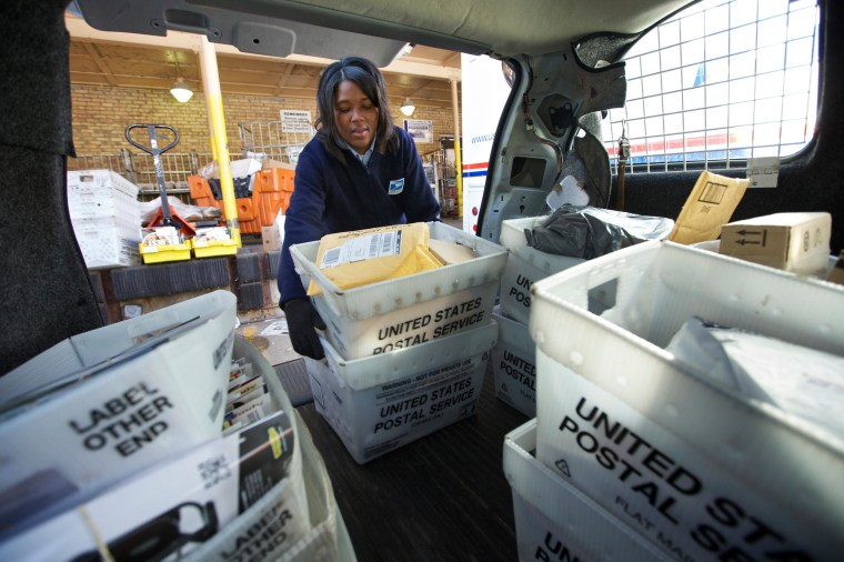 The United States Postal Service posted a quarterly loss as first-class mail delivery dropped, but the overnight package business is keeping it afloat.