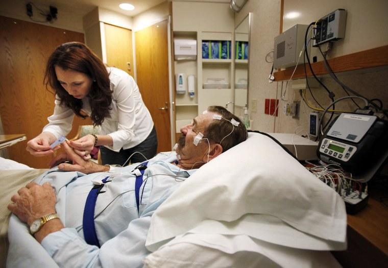 Image: Amanda Rasmuson prepares Chisholm for an overnight sleep evaluation for a sleep study at UW Hospital's Clinics in Madison, Wis.