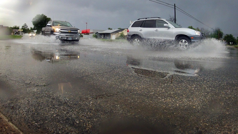 Image: Vehicles drive along wet conditions in Wichita Falls, Texas