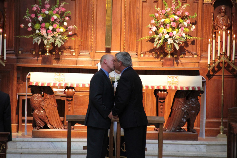 David Bucher, 49, and Bruce Moats, 50, of Maryland kiss at their wedding in Annapolis.