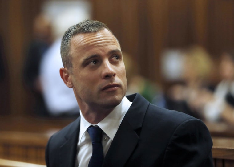 Image: Oscar Pistorius  sits in the dock on Tuesday.