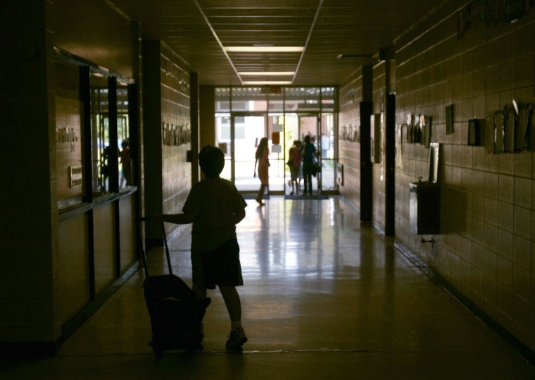 Image: Students walk through the hallways at Charleston Middle School in Charleston, Ark.