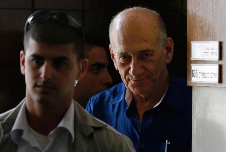 Image: Former Israeli Prime Minister Ehud Olmert leaves Tel Aviv District Court