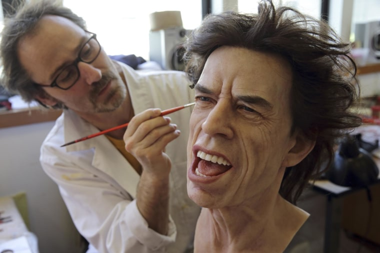 Image: Grevin Wax Museum painter Bruneau works on the head of Rolling Stones lead singer Mick Jagger at their workshop in Paris