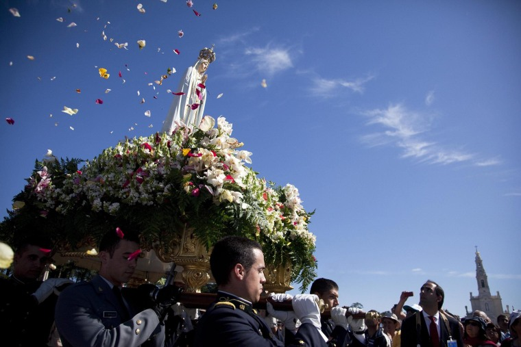 Image: The Our Lady of Fatima statue is carried during the procession of the annual Fatima Sanctuary pilgrimage