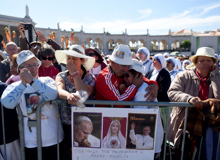 Image: Faithful attend a mass at the Catholic shrine of Fatima on Tuesday