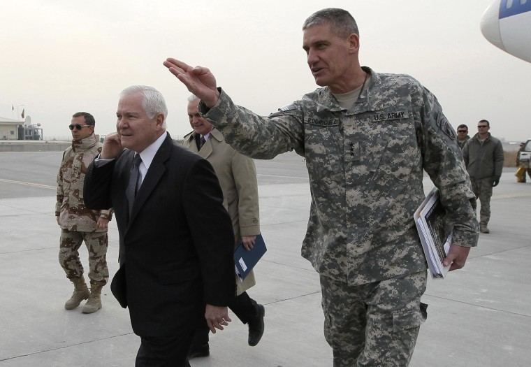 Image: U.S. Secretary of Defense Robert Gates is guided by U.S. Army Lt. General David Rodriguez after landing at Kabul International Airport