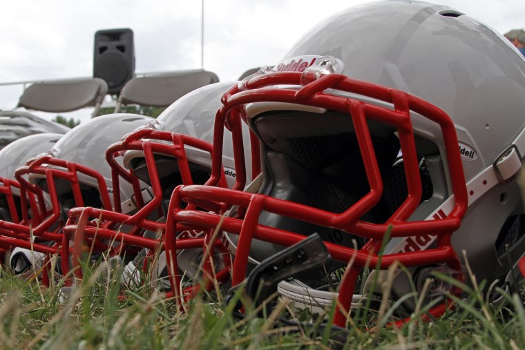 New football helmets were given to a group of youth football players from the Akron Parents Pee Wee Football League in Akron, Ohio, Aug. 4, 2012.