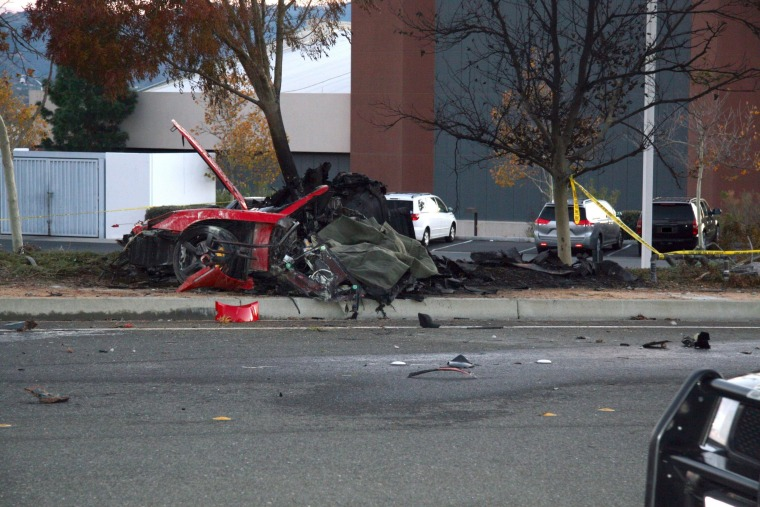 Image: The wreckage of a Porsche that crashed while carrying actor Paul Walker and driver Roger Rodas