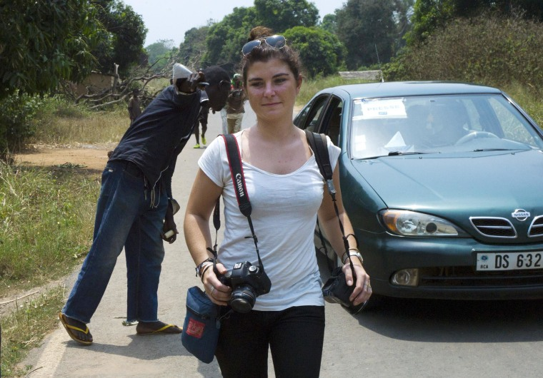 French journalist Camille Lepage walks with her cameras in Damara, 70km north from Bangui, on Feb., 21, 2014. French journalist Camille Lepage, 26, has been killed while on a reporting assignment in Central African Republic, French President Francois Hollande said on May 13.