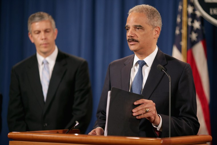 Image: Attorney General Holder and Education Secretary Arne Duncan Announce Action To Protect Military From Unfair Lending Practices