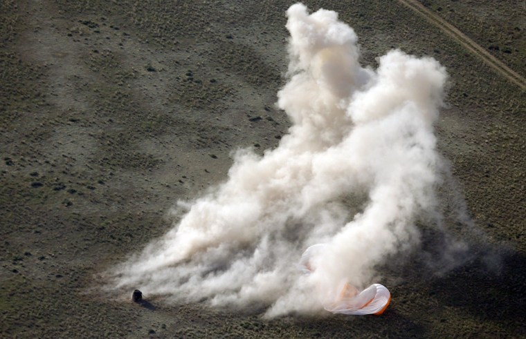 Image: Dust rises near the Russian Soyuz TMA-11M space capsule shortly after its landing