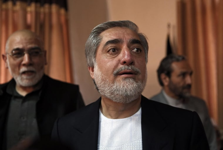 Afghan presidential candidate Abdullah Abdullah arrives for a news conference, in Kabul, Afghanistan, Sunday, April 27, 2014.