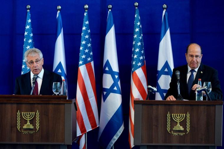 Defense Secretary Chuck Hagel, left, and Israel's Defense Minister Moshe Yaalon, right, speak following a meeting in Tel Aviv on Thursday.