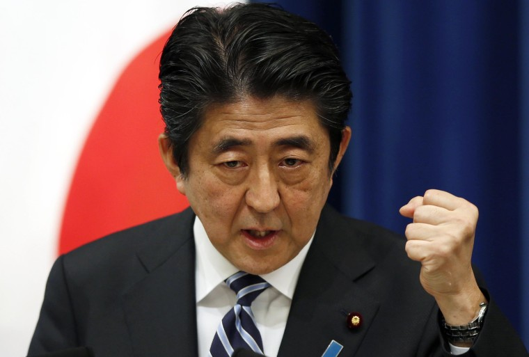 Image: Japanese PM Shinzo Abe speaks during a news conference on Thursday