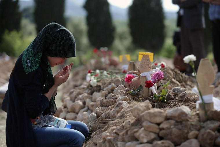 A woman prays at the grave of Ibrahim Duman, 26, a victim of the mine accident in Soma, Turkey, on May 15. An explosion and fire at a coal mine in Soma, some 155 miles south of Istanbul, killed hundreds of workers in one of the worst mining disasters in Turkish history.