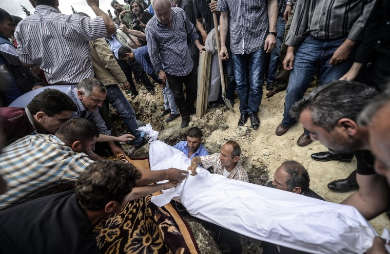 Image: People hold the body of a miner during a funeral ceremony on Thursday in Soma, Turkey