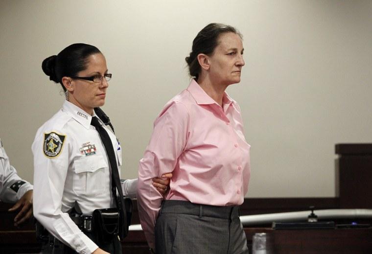 Image: Julie Schenecker is led into Judge Emmett Lamar Battles' courtroom on Thursday for closing arguments.
