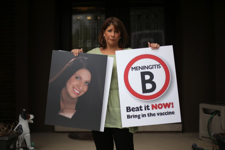 Image: Alicia Stillman holds a portrait of her 19-year-old daughter, Emily, who died in February 2013 from meningitis.