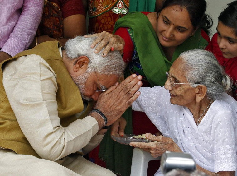 Image: Hindu nationalist Narendra Modi, the prime ministerial candidate for India's main opposition Bharatiya Janata Party (BJP), seeks blessings from his mother Heeraben