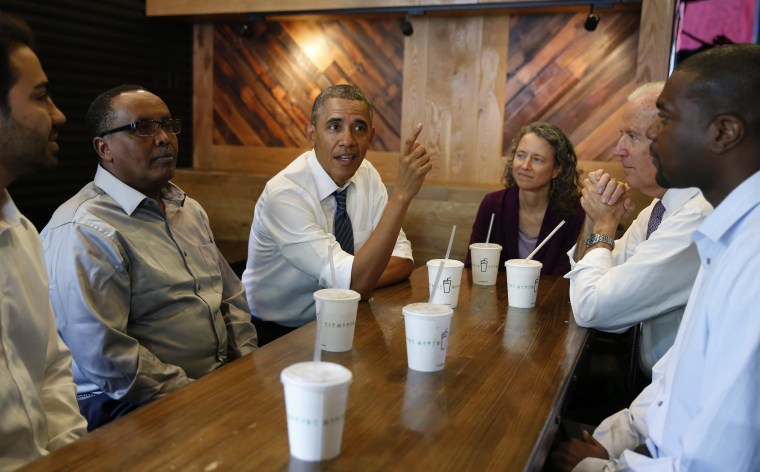 Image: U.S. President Obama talks while having lunch with Vice President Biden and construction workers at Shake Shack in Washington