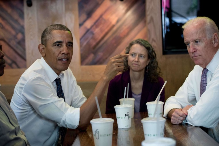 US President Barack Obama speaks with reporters as he has lunch with Vice President Joe Biden (R) and four workers from a neighborhood development project at a Shake Shack hamburger restaurant in Washington on May 16, 2014 to highlight his plan to increase investment in infrastructure.  AFP PHOTO/Nicholas KAMMNICHOLAS KAMM/AFP/Getty Images