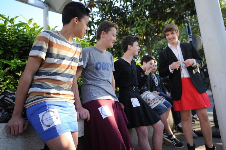 "Image: Students dress in skirts as part of the ""Ce que souleve la jupe"" (""What Raises the Skirt"") campaign"