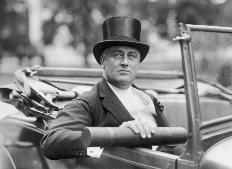 New York Governor Franklin D. Roosevelt, holding the honorary degree of Doctor of Laws, awarded him during ceremonies on July 21, 1929 at Harvard  University, Cambridge, Mass.