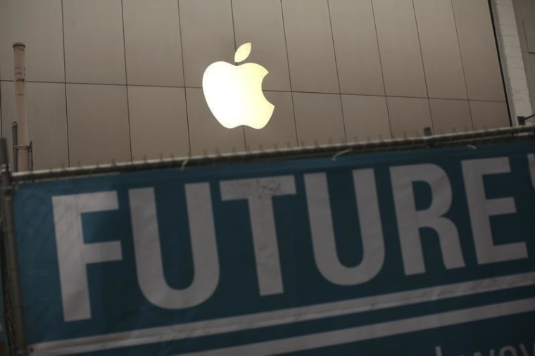 Image: Apple logo on the front of the company's flagship retail store near signs for subway project in San Francisco