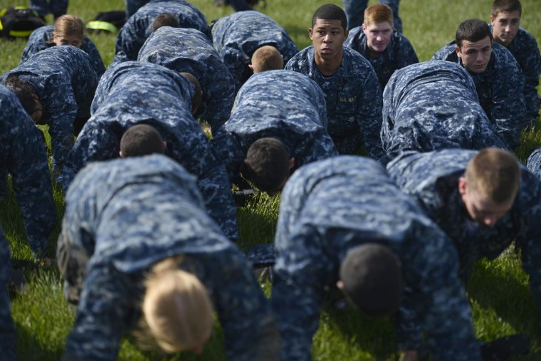 Midshipmen perform push-ups during the sea trials at the United States Naval Academy in Annapolis, Md., on May 14, 2013.