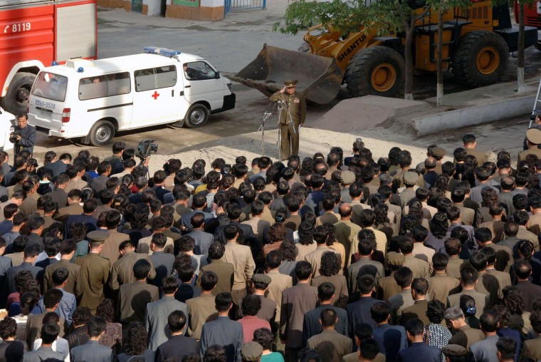 Image: North Korea apologizes over building collapse.