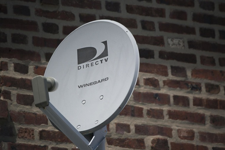 Image: File photo of a DirecTV dish is seen outside a home in the Queens borough of New York