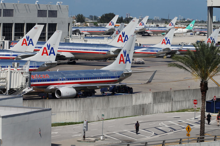 Image: American Airlines planes are seen at their gates at Miami International Airport