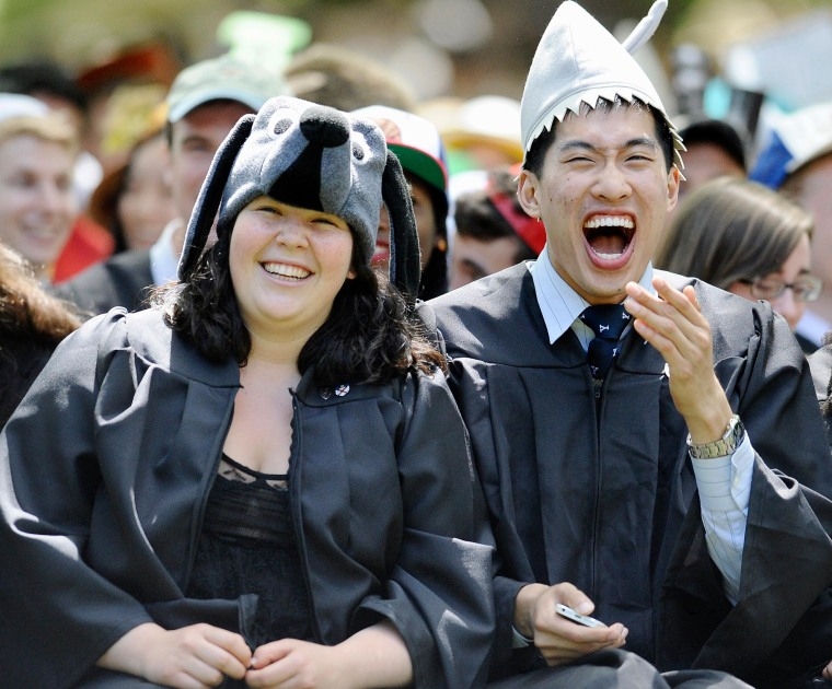 Image: Students react as Secretary of State John Kerry delivers the Class Day address at Yale University,