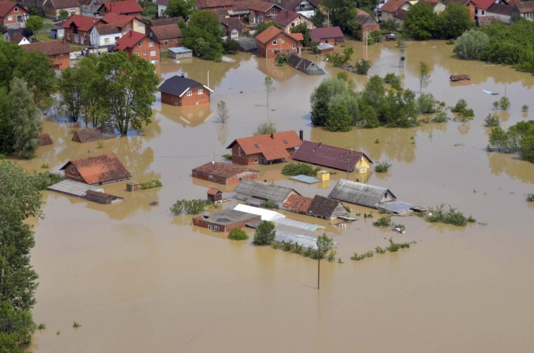 An aerial view of the flooded area near the Bosnian town of Brcko along the river Sava, 120 miles north of the Bosnian capital of Sarajevo. Three months' worth of rain fell on the Balkan region in three days, producing the worst floods since rainfall measurements began 120 years ago.